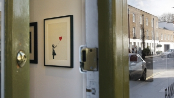 Banksy Artwork Self-Destructs Moment After $1.4 Million Sale