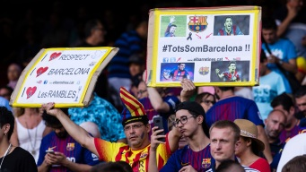 Honoring Victims of Attacks, Barcelona Wins League Opener