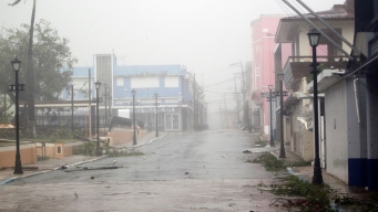 Locals Try to Contact Loved Ones in PR as Maria Strikes