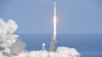 SpaceX's Big New Rocket Blasts Off, Puts Sports Car in Space
