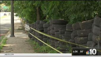 Local Church Cleans Up Tires Dumped on Property