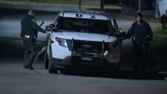 Gunman Kills Officer, Self; Woman Found Dead After Fight
