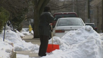 Neighbors Helping One Another Dig Out After Winter Storm