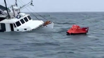 Coast Guard Saves Three Boaters