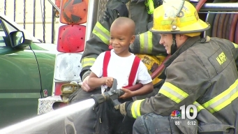 Philadelphia Firefighters Get a Helping Hand From Young Boy