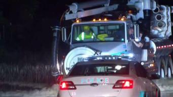 Driver Hangs Onto Truck After Getting Stuck on Flooded River Road