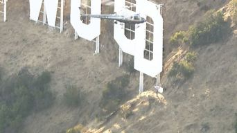 Man Climbs Hollywood Sign Waving Flag