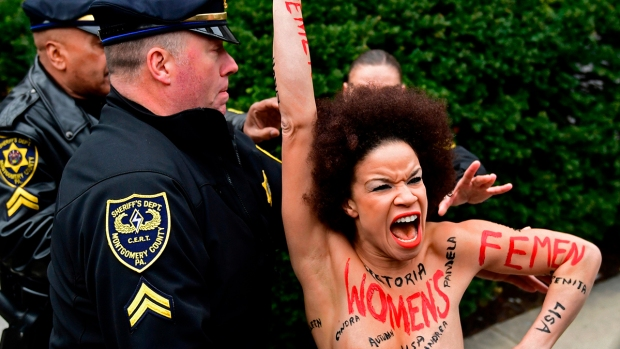 [PHI] Raw Video: Topless Protester Jumps in Front of Bill Cosby