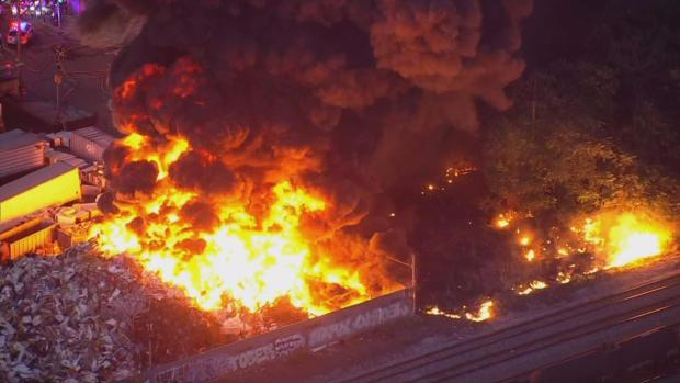 Firefighters Battle Massive Junkyard Fire