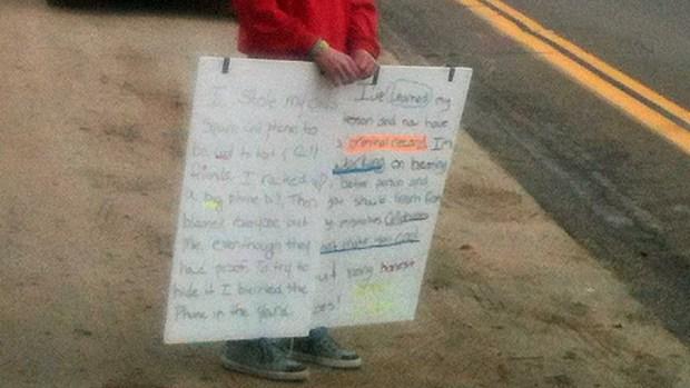 [DGO] Boy Holds Sign as Public Punishment