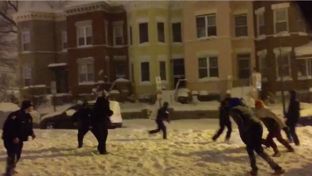 [NATL] Officers Join Pickup Football Game in Snowstorm