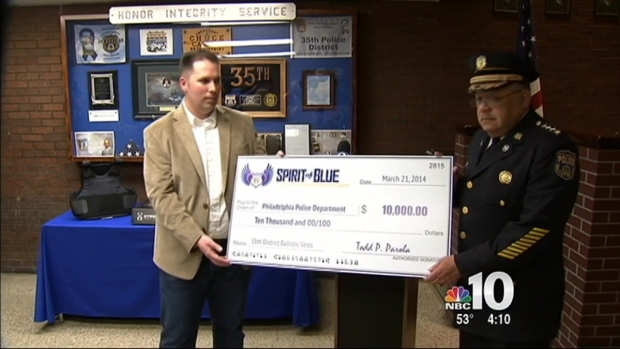 [PHI] Police Get 10k in Honor of Fallen Officer