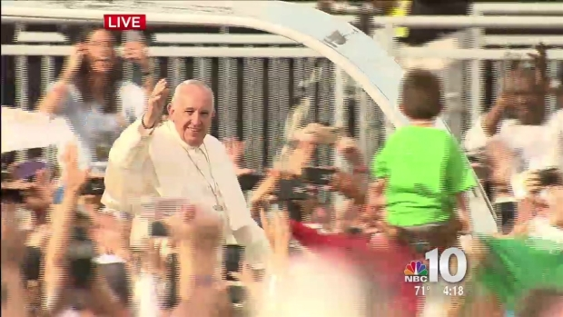 Pope Stops Motorcade to Kiss Baby