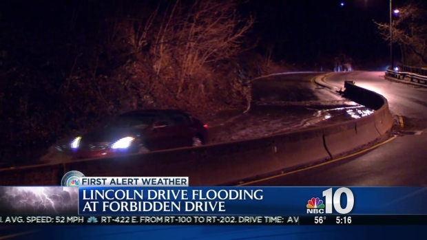 Drivers Plow Through Standing Water on Lincoln Drive