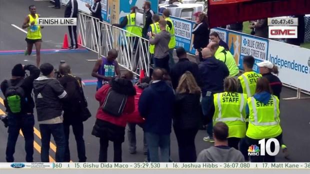 First Men's Runner Crosses Finish Line