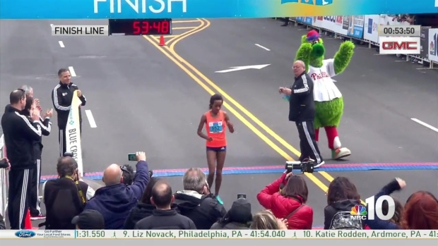 First Women's Runner Crosses the Finish Line