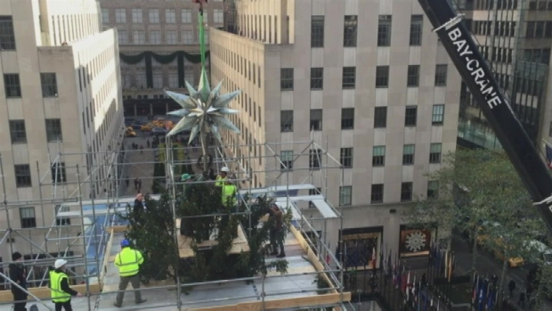 [NY] WATCH: Swarovski Star Hoisted Onto Rock Center Tree