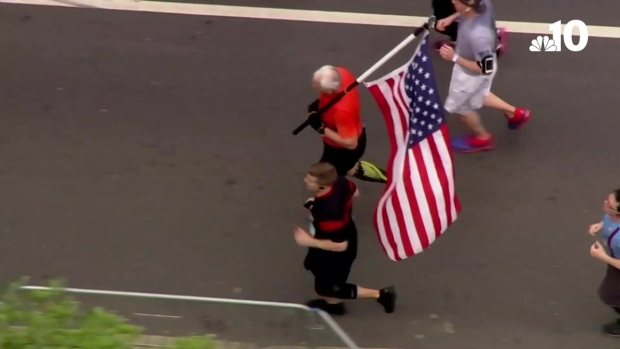 American Flag-Carrying Runner Explains History of His Tradition