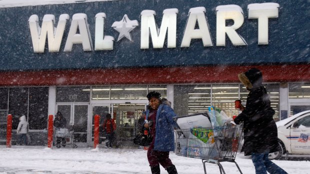 19, 2009 photo, shoppers struggle with their cart in the snow during a snow storm in Philadelphia. Photo credit: AP