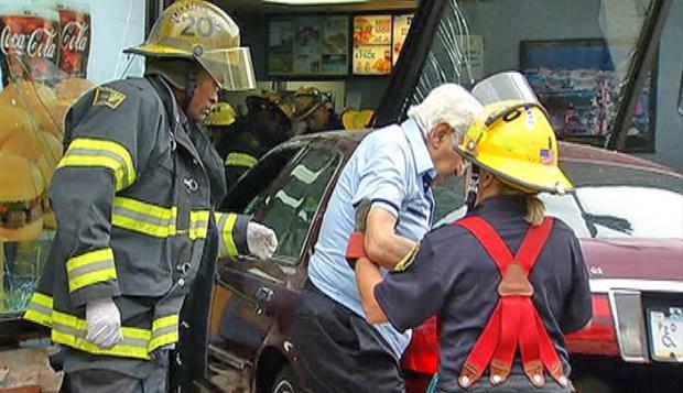 [PHI] Raw Video: Man Walks Away From Fast Food Crash