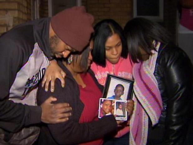 [PHI] Mourners Comfort Each Other After Fire Kills Family of 4