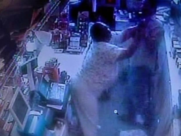 [PHI] Caught On Tape: Woman Clobbers Gas Station Clerk  Over Money