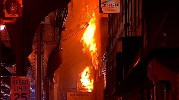PHOTOS: Fire Rips Through NoLibs Factory