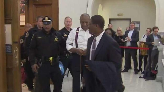 Watch: Bill Cosby Led Out in Cuffs