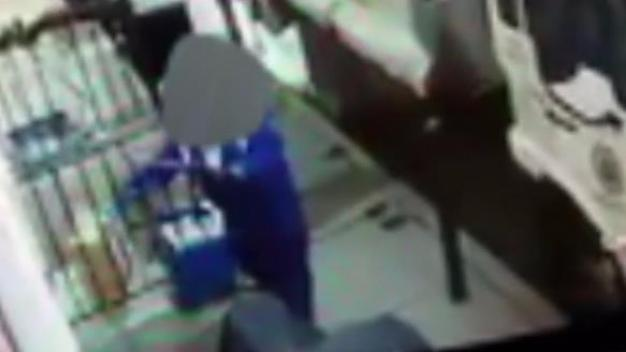 Video Appears to Show Trash Worker Picking up Package