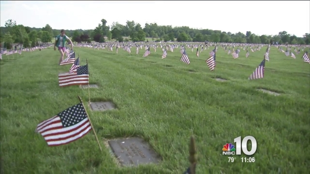 Scouts Place Flags on Veterans' Graves
