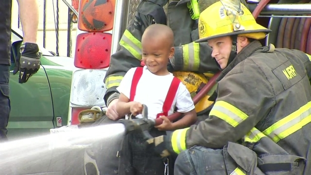 Little Boy Gives Firefighter a Hand in North Philly