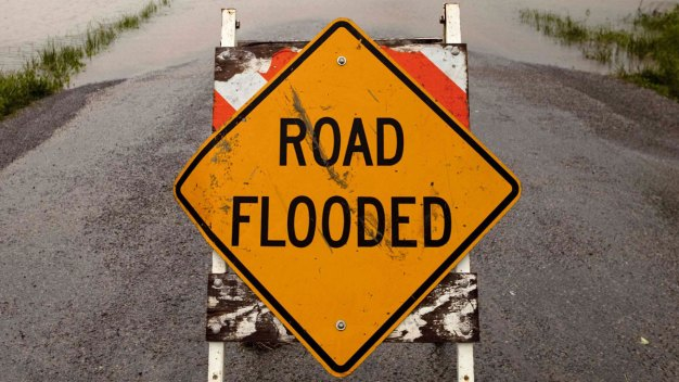 Heavy Downpours Bring Flood Threat