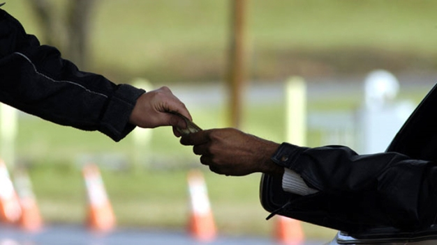 Ex-NJ Toll Taker Files Suit Over 'God Bless You'