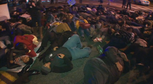 """Protesters Stage """"Die-In"""" Outside of Eagles Game"""