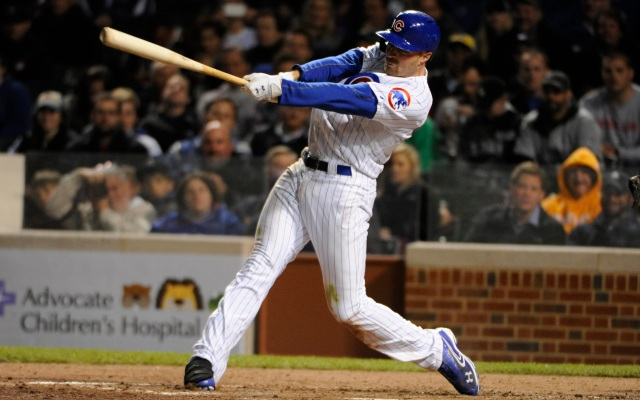 CHICAGO, IL - MAY 13: Nate Schierholtz #19 of the Chicago Cubs hits a two-RBI triple against the Colorado Rockies during the seventh inning  on May 13, 2013 at Wrigley Field in Chicago, Illinois.   (Photo by David Banks/Getty Images)