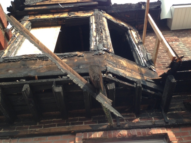 Why Are Burned Gesner St. Homes Still Standing?