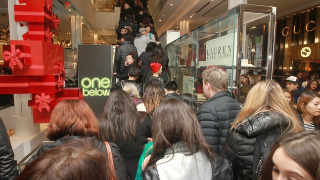 Online Sales Surge, but Thousands Lining Up for Black Friday