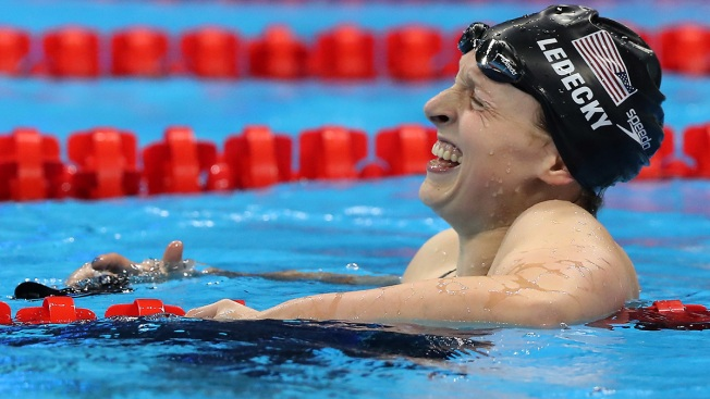 Fast track; Ledecky sweeps freestyles with 800m world record; Phelps second