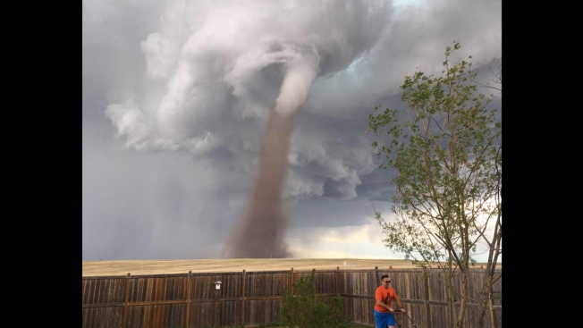 Big Tornado Doesn't Bother Man Mowing Lawn in Canada