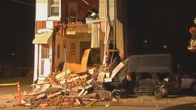 Woman Hurt After SUV Slams Into Home