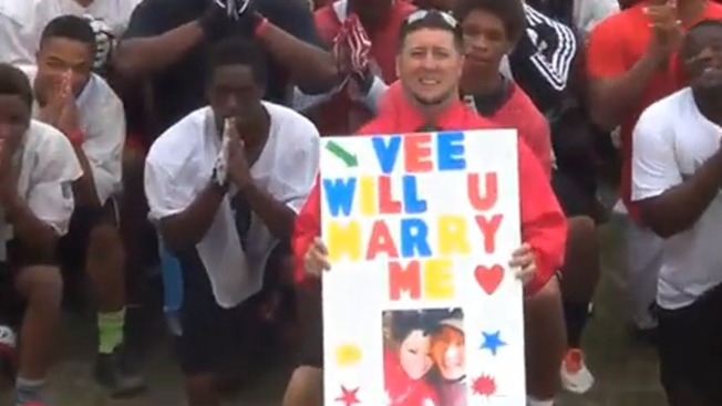WATCH: High School Football Coach Uses Players to Propose to Girlfriend