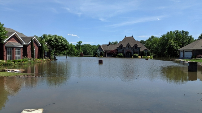 Oklahomans Clean Up After Flood; Arkansans Brace for Crest