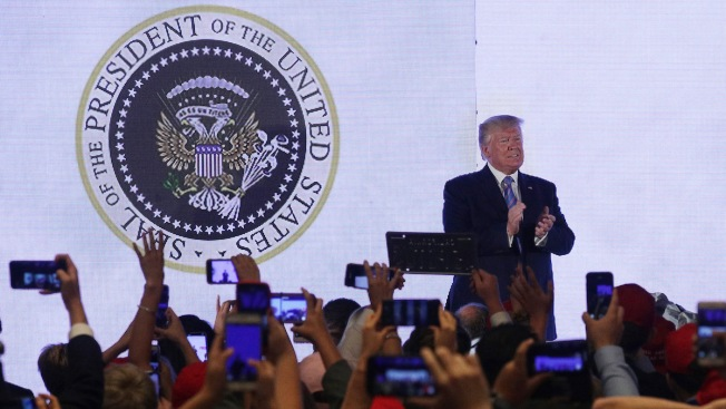 '45 Is a Puppet': Trump Appears in Front of Altered Presidential Seal