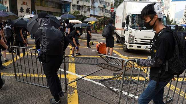 Thousands March Again, Gas Bombs Thrown in Hong Kong