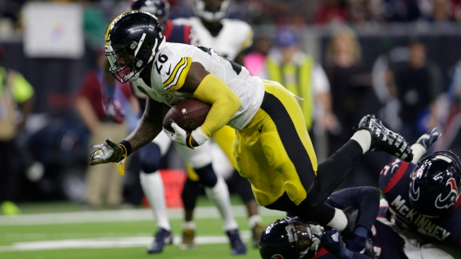 Steelers rout Texans to clinch playoff bye