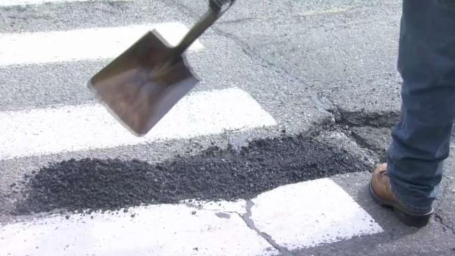 'You Got to Play Football Around These Joints. Real Rap': Fixing the Worst Potholes in Philadelphia