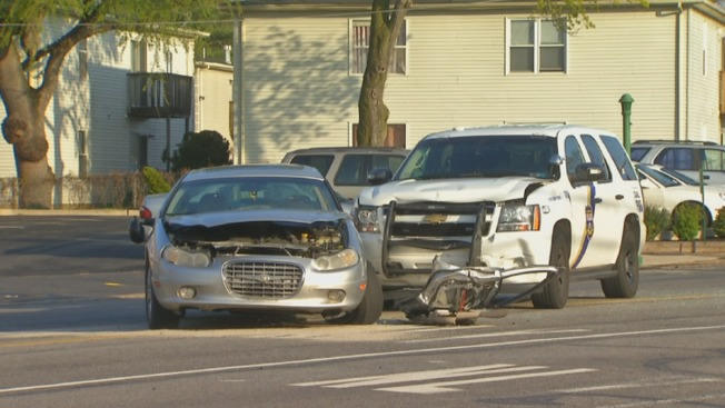 Police Officer, Woman Hurt in Car Crash