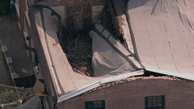 Roof of Apartment Building and Pub Partially Collapses
