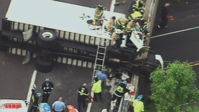 Driver's Leg Partially Amputated After Truck Overturns