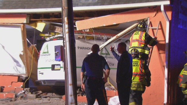 1 Hurt, 4 Displaced After Utility Van Slams Into Building